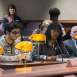 Nandan Tumu, left, a representative of the Undergraduate Student Government and the Board of Trustees, testifies, as Akshayaa Chittibabu, listens, during testimony to the Appropriations Committee of the Connecticut General Assembly on March 7. (Ariel Dowski for UConn)
