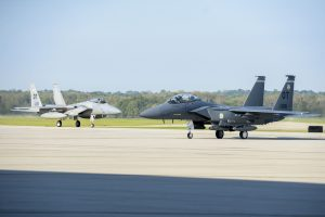 A pair of F-15 Eagles from Eglin Air Force Base, Florida, taxi after landing at Wright-Patterson Air Force Base, Ohio in preparation for landing and safe haven, Oct. 9, 2018. The F-15 is one of several planes taking safe haven at Wright-Patterson AFB, as Hurricane Michael threatens their home station. (U.S. Air Force photo by Wesley Farnsworth)