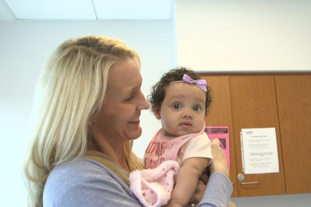 Shea Ralph with her daughter. (Frank Barton/UConn Health Photo)