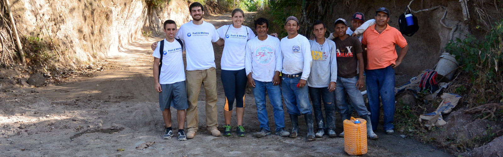 Students stand with Nicaraguan villagers.