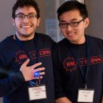 Zach Sola '19 (ENG) and Ray Li '19 (ENG), show off their 'Hydr8' – a ring designed to monitor water consumption and encourage people to drink enough water daily. (Lucas Voghell '20 (CLAS)/UConn Photo)
