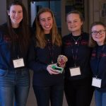 Kiera Burns '21 (ENG), Christina Bibinski '22 (CLAS), Olivia Tirelli '22 (CLAS) and Megan Walsh '21 (ENG) show off their GDD x19, a device used to quickly analyze blood samples and show blood sugar levels and insulin levels to aid in overdose identification. (Lucas Voghell '20 (CLAS)/UConn Photo)