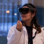Norlinda Stewart '22 (ENG) demonstrates her team's idea of using Microsoft HoloLens technology to give nurses quick access to patient information. (Lucas Voghell '20 (CLAS)/UConn Photo)