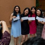 A group of medical students show off the envelopes containing their residency assignments before opening them at the  residency match day ceremony held in the Academic Atrium at UConn Health in Farmington on March 15, 2019. (Peter Morenus/UConn Photo)