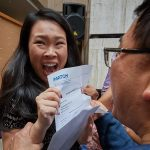 Julianna Lau reacts as she opens the envelope containing her residency assignment during the medical student residency match day ceremony held in the Academic Atrium at UConn Health in Farmington on March 15, 2019. (Peter Morenus/UConn Photo)