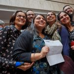 Medical student Roshni Patel poses for a photo with her family during the residency match day ceremony held in the Academic Atrium at UConn Health in Farmington on March 15, 2019. (Peter Morenus/UConn Photo)