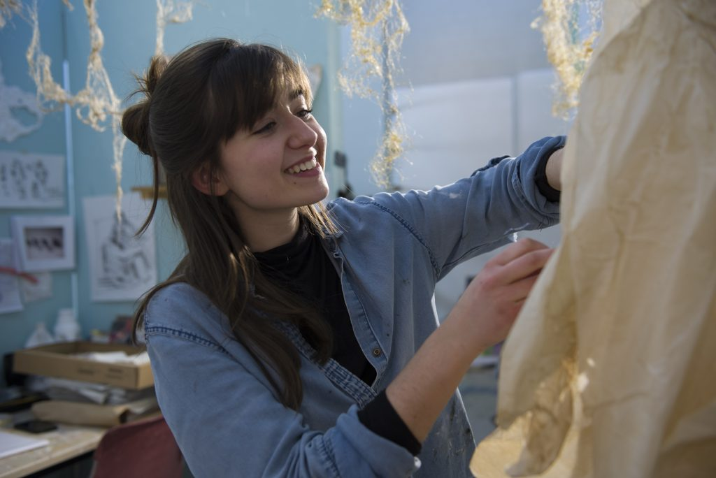 Isabella Saracena, SFA '19, is researching forgotten women artists from the past and recognizing their contribution through her own original works. (Tiffany Taylor/UConn Photo)