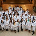 Second year dental students pose for a photo at the UConn Health academic atrium in Farmington following their white coat ceremony on March 22. (Peter Morenus/UConn Photo)