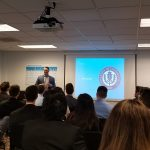 William Facteau '92 (CLAS) addresses the group of UConn students at Earlens Corp., where he is chairman, president and CEO. (Submitted Photo)