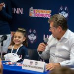 Daniela with Coach Geno Auriemma on her signing day, Nov. 11, 2018. (Jason Reider/Athletic Marketing Photo)