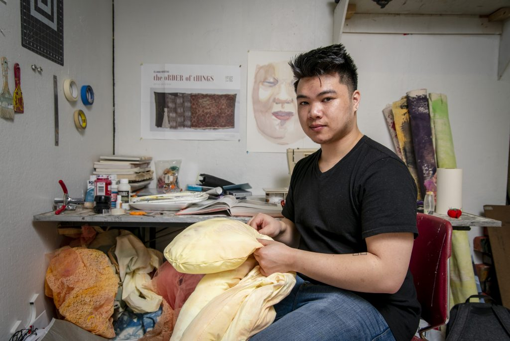 James Keth '19 (SFA) working on his senior project in his studio at the School of Fine Arts, Art Building on March 25, 2019. (Sean Flynn/UConn Photo)