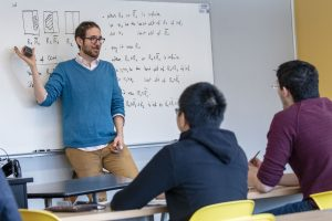Math professor Damir Dzhafarov teaches a graduate class in logic in the Monteith Building. (Sean Flynn/UConn Photo)