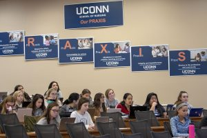 Nursing students listen to a lecture in the Widmer Wing of the School of Nursing. (Sean Flynn/UConn Photo)