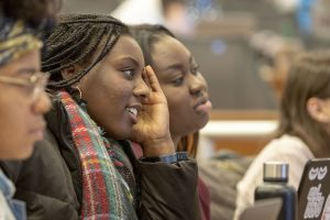 Lauryn Bryant '21 (NUR), left, and Natalie Akumiah '21 (NUR) listen to a lecture in the Widmer Wing of the School of Nursing. (Sean Flynn/UConn Photo)