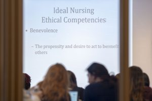 Nursing students listen to a lecture about ethics in the field. (Sean Flynn/UConn Photo)