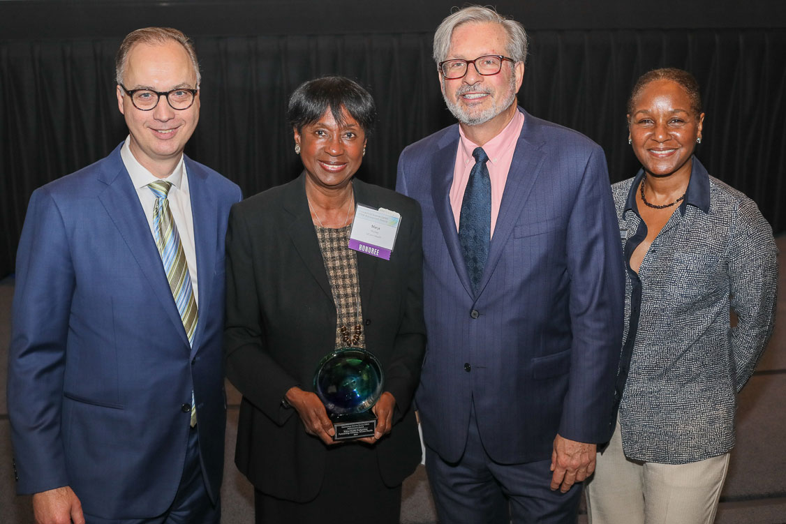 Dr. Marja Hurley accepts a 2019 STEM Achievement Award from Connecticut Science Center' Matt Fleury and Amy Sailor, and State Rep. William Petit.