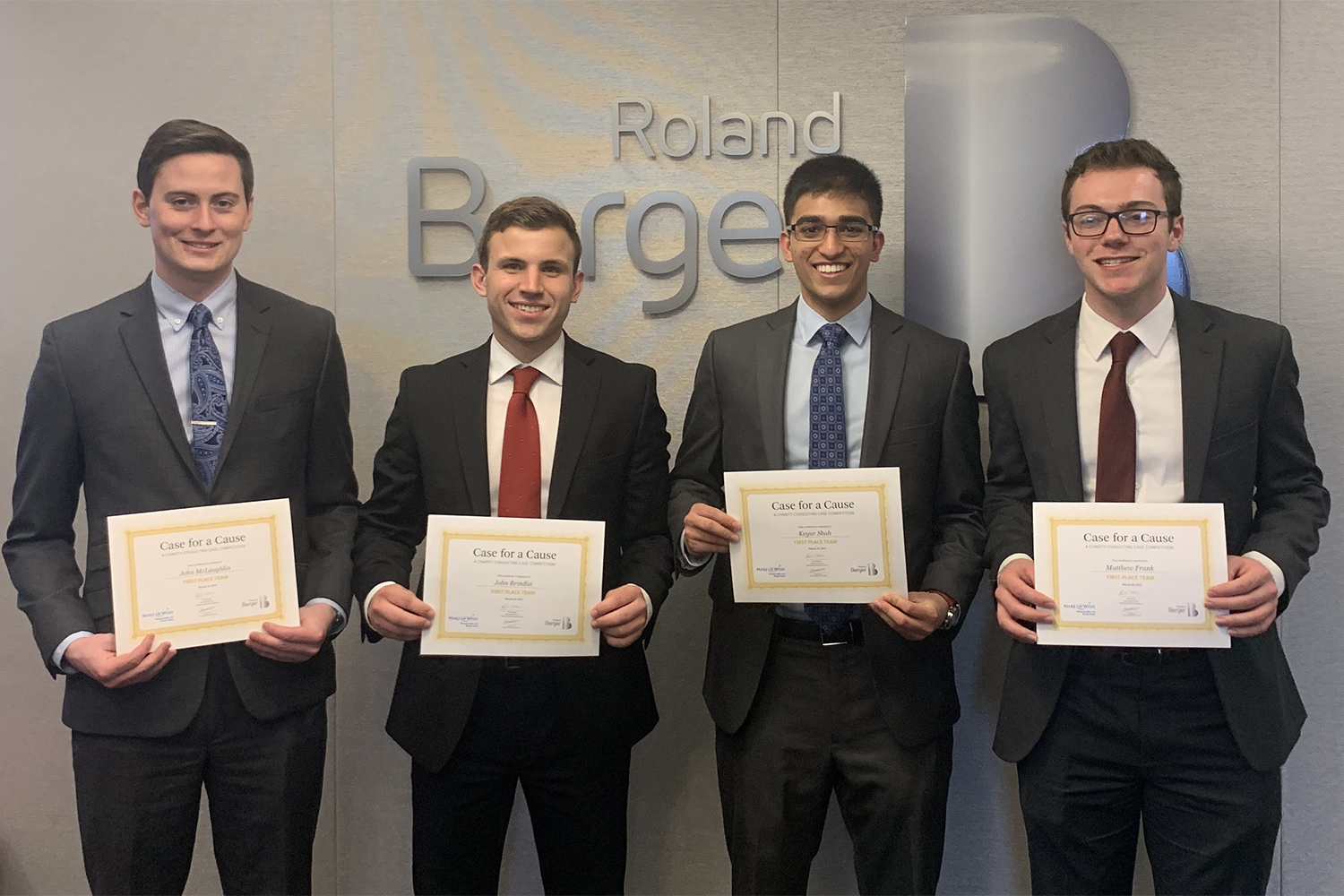 """Left to right, John McLaughlin, John Brindisi, Keyur Shah, and Matthew Frank accepting their awards at the """"Case for a Cause"""" competition (Photo courtesy of John McLaughlin)"""