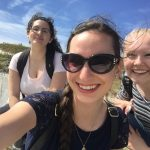 Anna Aldrich, center, at the Cliffs of Dover with UConn students Sarah Motta, left, and Addison Kimber.