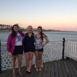 Anna Aldrich, right, in Brighton, England, with UConn students Sarah Motta, left, and Addison Kimber.