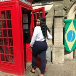 Drew Asia-Keating checks out an iconic phone booth ('telephone box') in London.