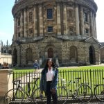 Drew Asia-Keating in front of the Radcliffe Camera in Oxford, part of the University of Oxford Library.
