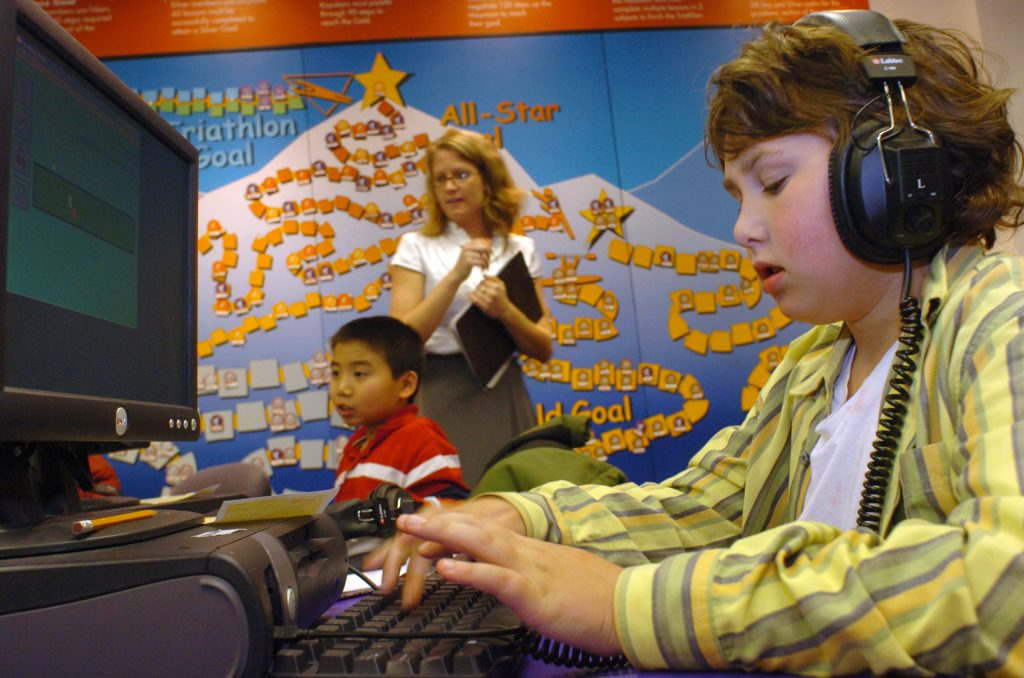 A fifth-grader works at a computer during an after-school learning program. (Farah Nosh/Getty Images)