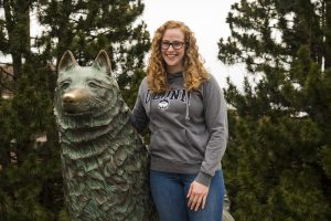 Kathrine Grant in front of the UConn Husky statue.