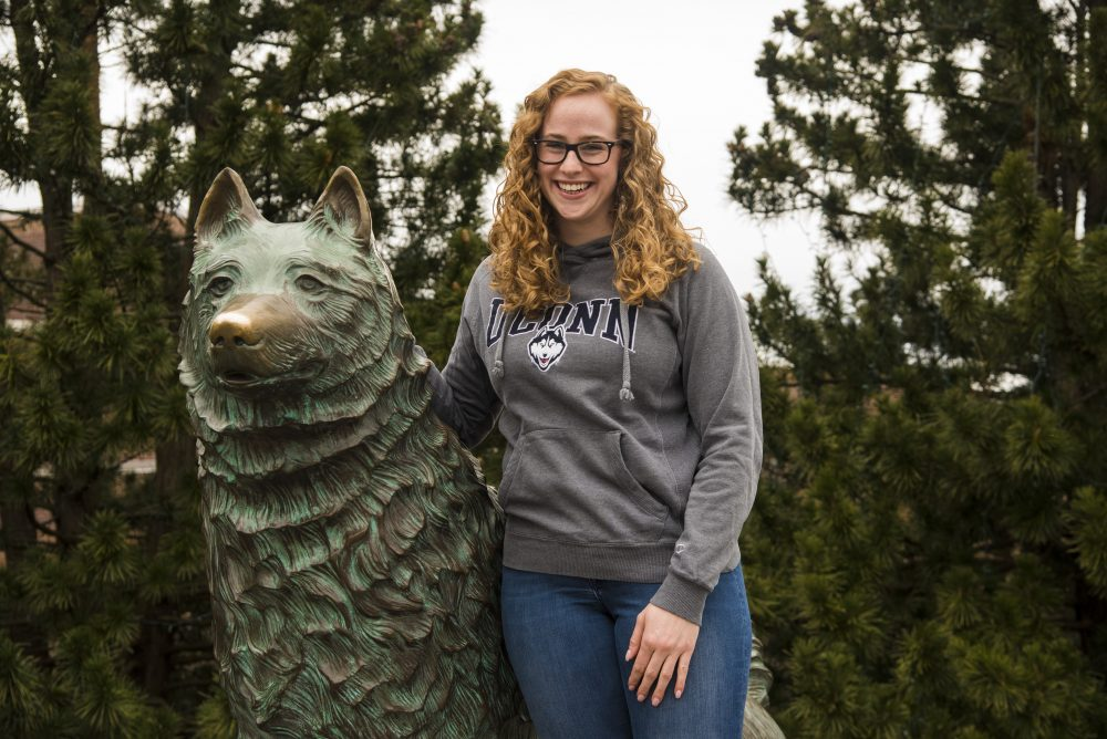Kathrine Grant in front of the UConn Husky statue. (Submitted Photo)