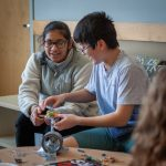 Kashvi Bokria, left, and Sophia Wong from Timothy Edwards Middle School in South Windsor, Connecticut, build a cantilever beam out of common materials to learn more about engineering. (Christopher LaRosa/UConn Photo)