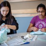 Angelina Lee, left, and Sristhi Chowdhury from Timothy Edwards Middle School in South Windsor, Connecticut use diapers to observe cross-linking of polymers. (Christopher LaRosa/UConn Photo)