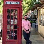 Omaniel Ortiz '20 (CAHNR) outside a phone booth, or 'telephone box,' in the London neighborhood where the UConn group lived.
