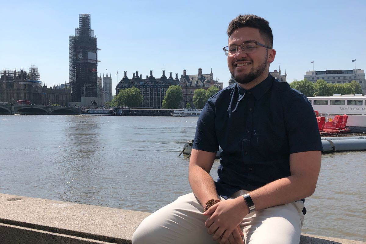 Omaniel Ortiz '20 (CAHNR) by the River Thames with Big Ben (shrouded in scaffolding) in the background. Big Ben, the iconic clock tower of the Houses of Parliament in London, is currently undergoing major renovations.