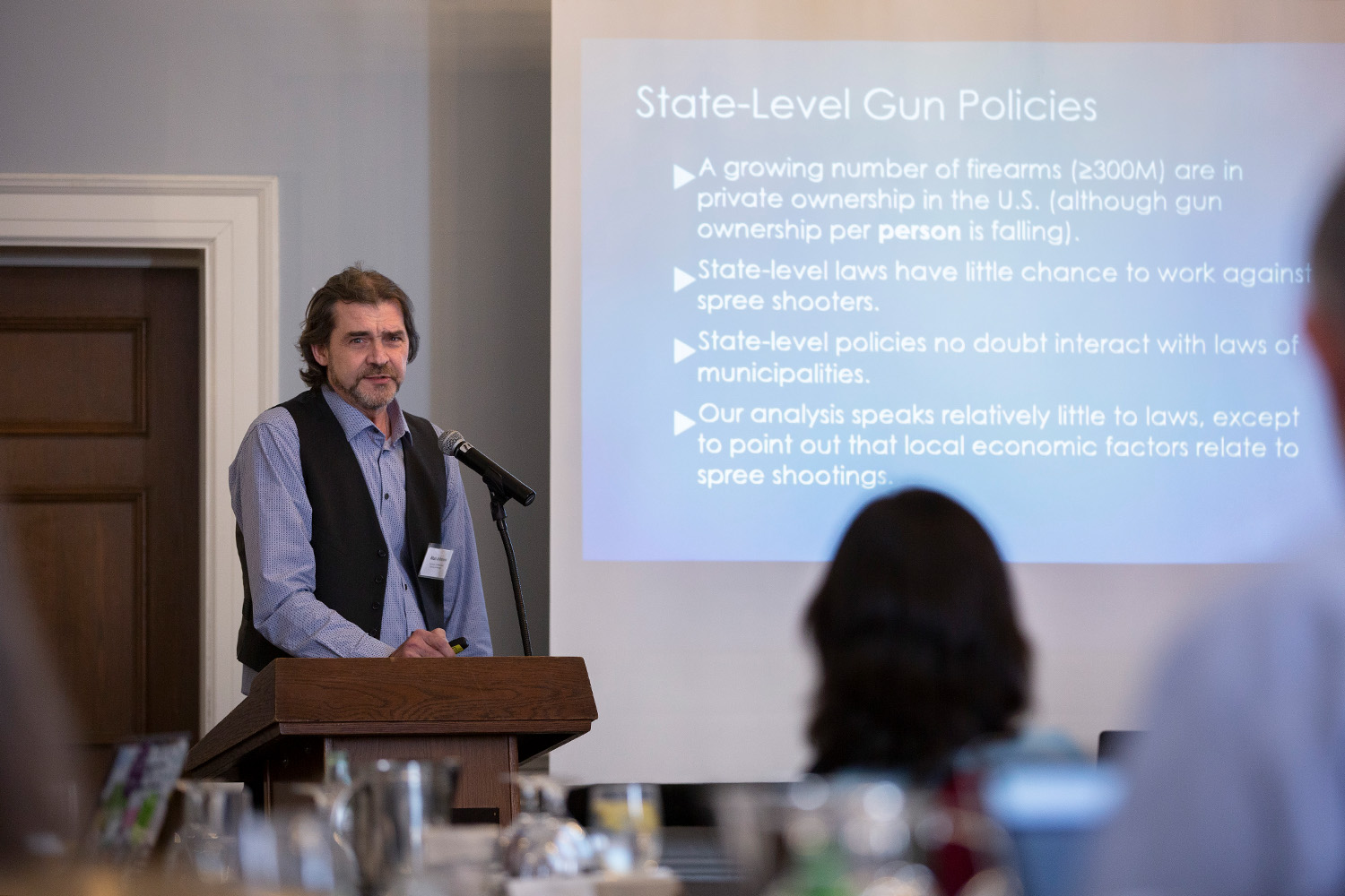 Blair T. Johnson, Board of Trustees Distinguished Professor of Psychology, presents at the Correlates, Causes, and Solutions for Firearm Violence in America conference at the Hartford Club on April 4, 2019. (Bri Diaz/UConn Photo)