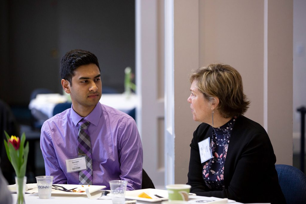 Saurabh Kumar speaks with physiology and neurobiology professor Joanne Conover during the Office of National Scholarships and Fellowships' 2019 Celebration of Excellence at the Alumni Center on April 23. (Bri Diaz/UConn Photo)