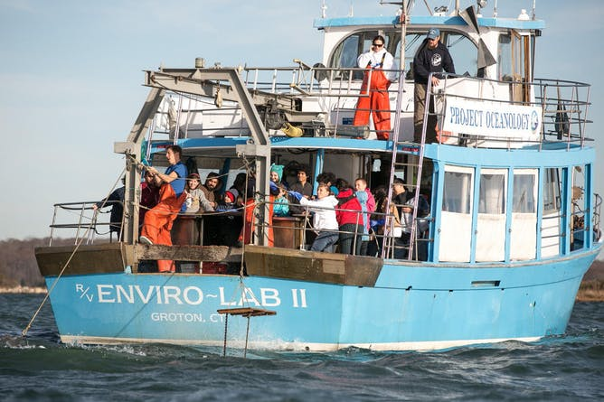 Project Oceanology class retrieves a bottom trawl at the mouth of the Thames River. (Anna Sawin/UConn Photo)