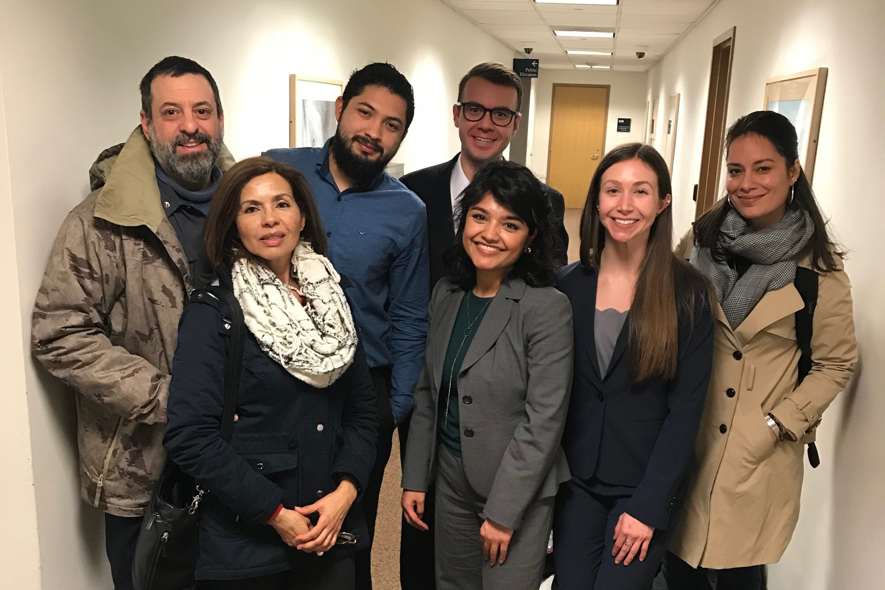 Left to right, two members of the Galdamez family; Franklin René Ruano Galdamez; Adam Kuegler (back) law student; Valeria Gomez, William R. Davis Clinical Fellow at UConn Law; Alexandria Madjeric, law student; and Thais Ortolaza, UConn School of Social Work student intern. (Camille Chill/UConn Photo)
