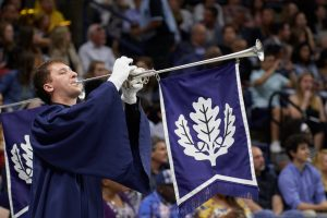 Herald pipers announce the arrival of the faculty during the College of Agriculture, Health, and Natural Resources commencement ceremony at Gampel Pavilion on May 11, 2019. (Peter Morenus/UConn Photo)