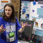 Madison Cavill, 10, shows off her invention 'Fresh-E,' designed to give people a personalized way to combat odor. (Lucas Voghell '20 (CLAS)/UConn Photo)