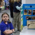 Josalynn Barber, 8, demonstrates her 'Sea Straw,' which is designed to make sea water drinkable. (Lucas Voghell '20 (CLAS)/UConn Photo)