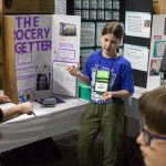 Mackenzie Smith, 9, shows how her invention 'The Grocery Getter' can assist elderly folk with their grocery shopping. (Lucas Voghell '20 (CLAS)/UConn Photo)