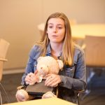 Kaitlin DiPietro '20 (NUR), shares her experience of creating a teddy bear and tablet combo to assist those suffering from delirium in hospitals. (Lucas Voghell '20 (CLAS)/UConn Photo)