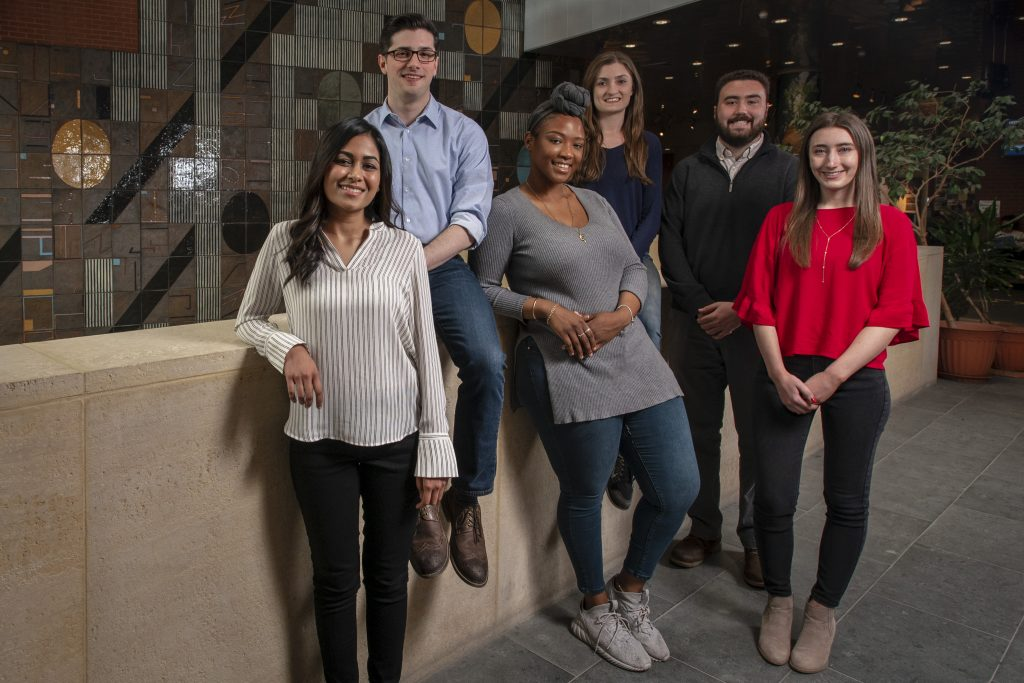 Six of this year's 11 UConn recipients of National Science Foundation graduate research fellowships at the Biology/Physics Building. From left, Hetal Patel, Eric Lepowsky, Leann McLaren, Angela Lanning, Connor Ligeikis, and Shaylin Cetegen. (Sean Flynn/UConn Photo)