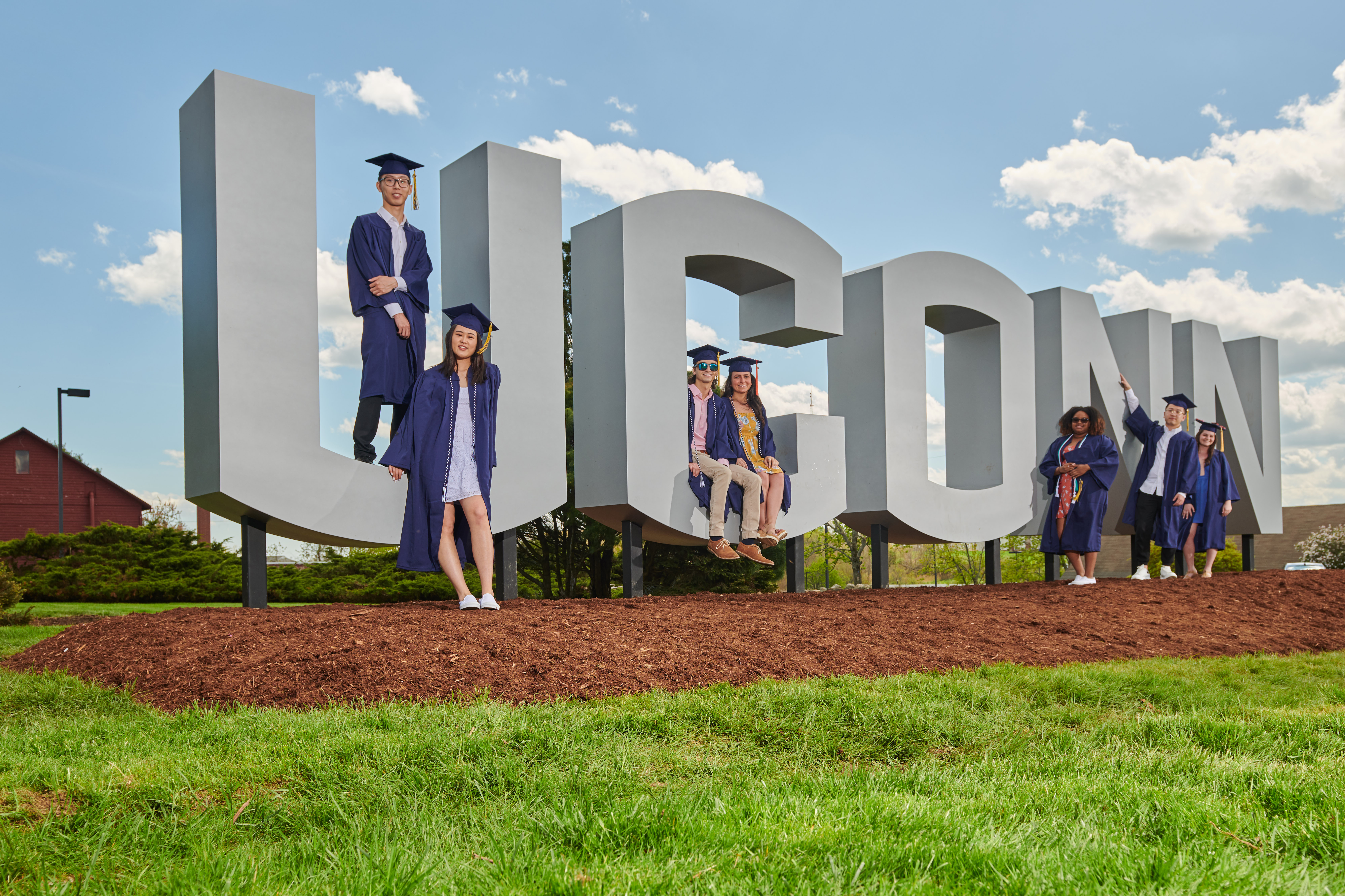 Soon to be graduates pose with the new UConn sign along Route 195. From left are Kailin Lu '19 (CLAS), Kai Lu '19 (CLAS), Harun Malik '19 (CLAS), Carley Corbo '19 (ENG), Sidayah Dawson '19 (CLAS), Zhenhao Zhang '19 (CLAS), and Debra Peel '19 (CAHNR). (Peter Morenus/UConn Photo)
