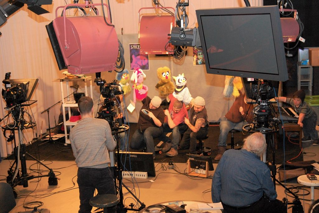 """Puppeteers rehearsing """"Spacebus 9"""" at the television studio at the Jorgensen Center for the Performing Arts"""