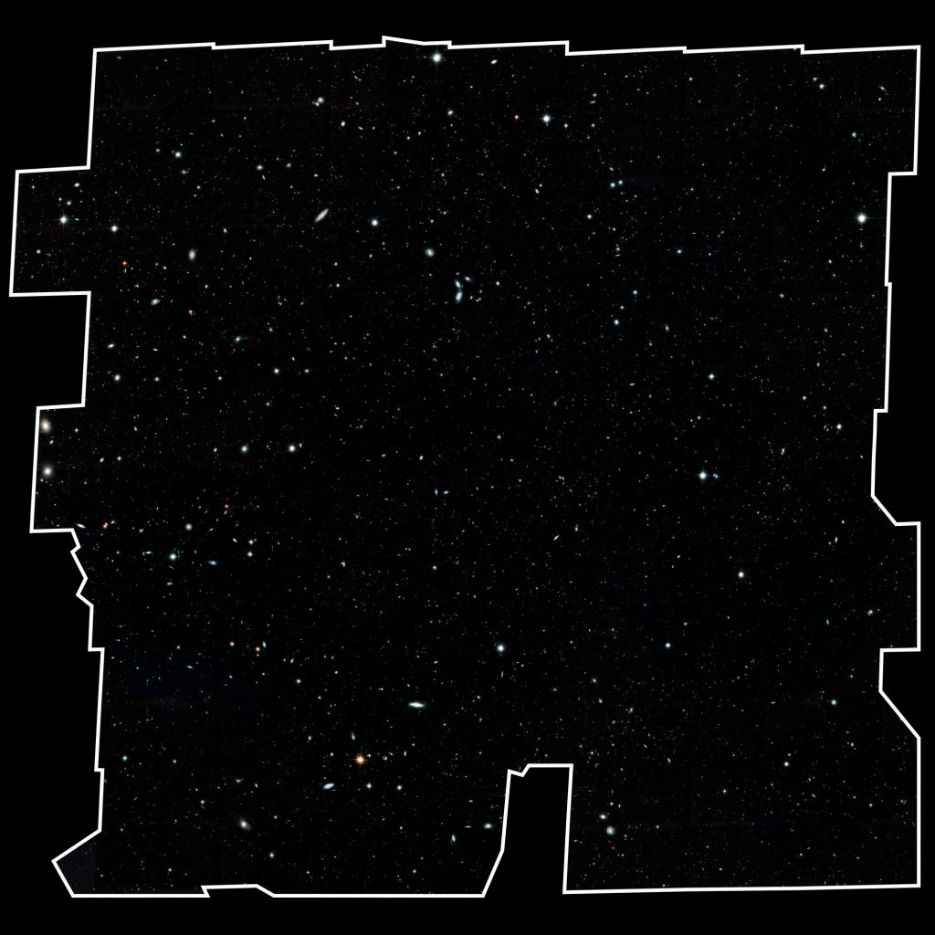 This image, a mosaic of nearly 7,500 separate Hubble exposures, presents a wide portrait of the distant universe and contains roughly 265,000 galaxies that stretch back through 13.3 billion years of time to just 500 million years after the universe's birth in the Big Bang. (Space Telescope Science Institute Image)