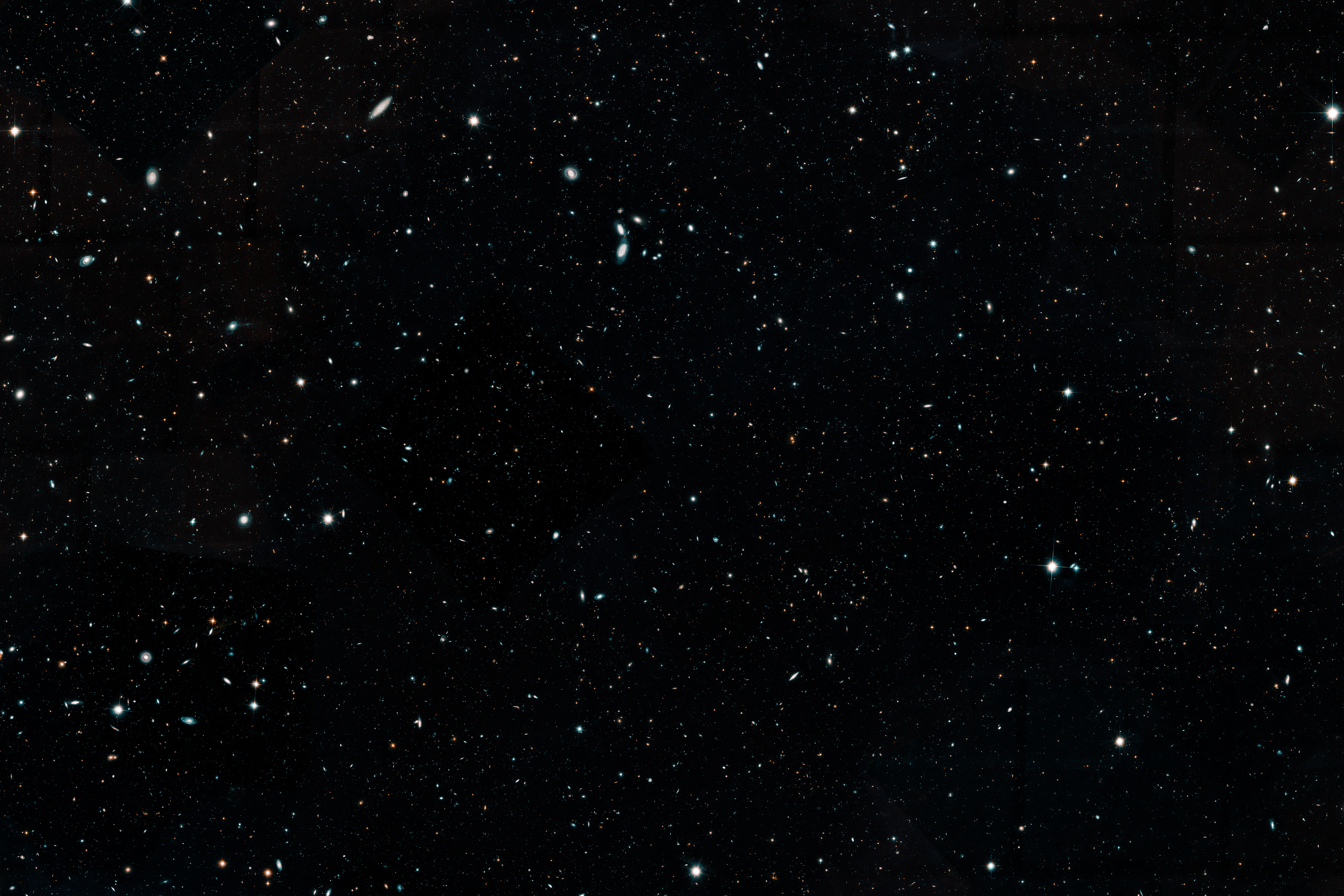 UConn astronomer Katherine Whitaker played a lead role in cataloging deep space images from 16 years' worth of Hubble Telescope observations. This composite image represents the largest, most comprehensive 'history book' of galaxies in the universe. The image is cropped here to fit. (Space Telescope Science Institute Image)
