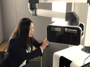 Yuanyuan Zhu, director of the InToEM center, works with the DENSsolution Climate system at UConn Tech Park. (UConn Photo)