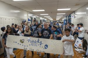 Kennelly School children and teachers, and UConn School of Education students parade through the school halls in celebration of UConn Day on May 2, 2019. (Sean Flynn/UConn Photo)