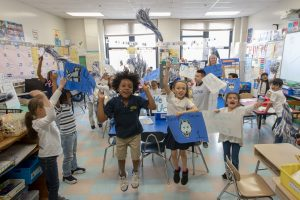 Kennelly School students cheer UConn pride in a classroom on May 2, 2019. (Sean Flynn/UConn Photo)