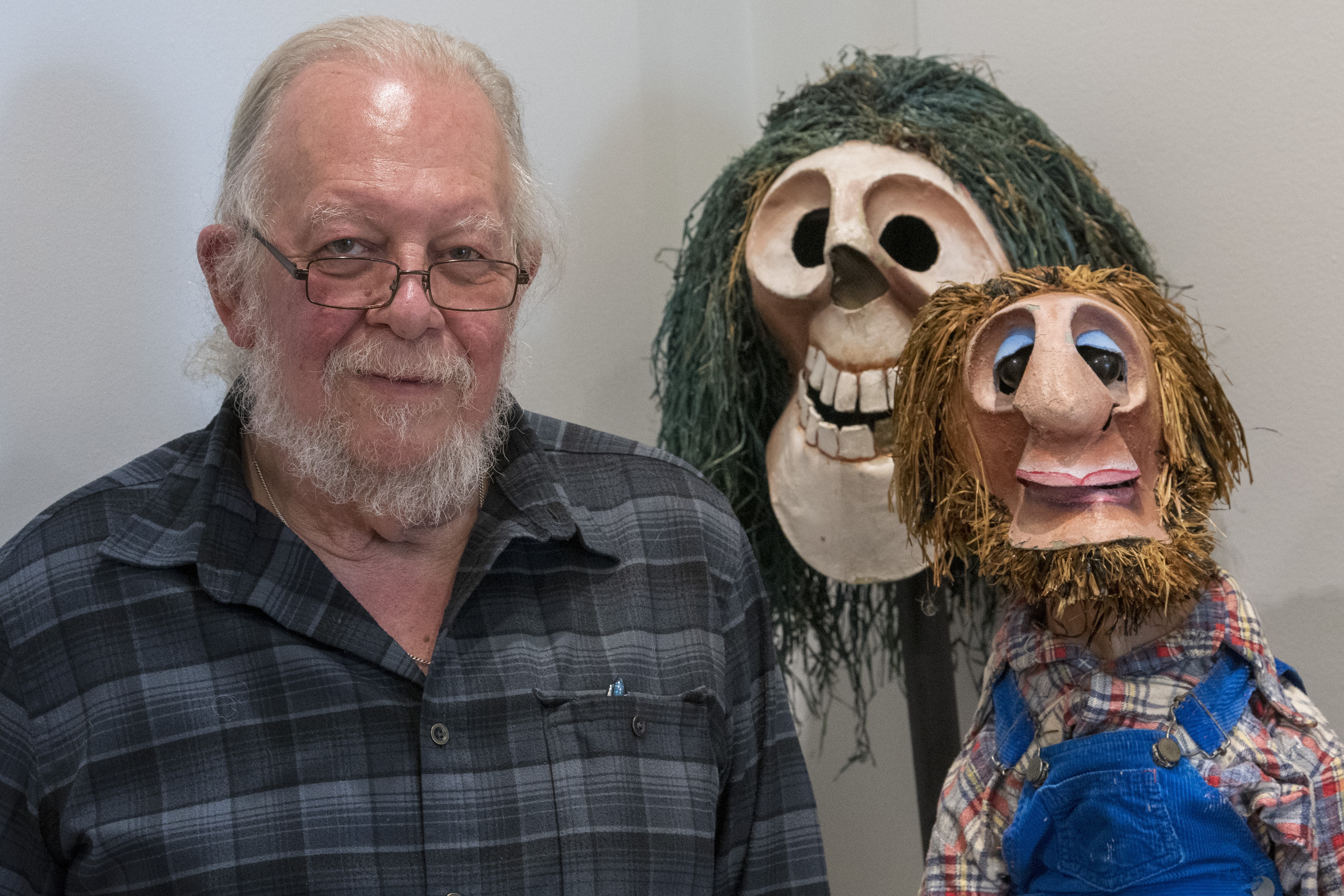 The Ballard Institute and Museum of Puppetry is celebrating Puppet Arts program director Bart Roccoberton's career as puppeteer and educator with an exhibition of nearly 100 puppets he and his collaborators and students created. Shown here are Captain Kidd (back) and Dougie Hutchins from 'Tales of the Leatherman'. (Sean Flynn/UConn Photo)
